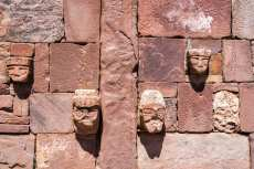 Faces on a wall in the semi-subterranean temple in Tiwanaku near La Paz, Bolivia